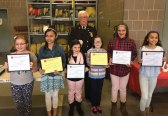 The Naugatuck Fire Department recently honored the local winners of 11th annual Connecticut fire prevention poster contest. All Naugatuck students in grades four and five were eligible to compete. The winners in fourth grade were Mariah Hawley (first place) from Maple Hill School, Marcella Baptistim (second place) from St. Francis-St. Hedwig School, and Christie Weir (third place) from Maple Hill School. The winners in fifth grade were Evelyn Morse (first place) from Cross Street Intermediate School, Julia Dumont (second place) from St. Francis-St. Hedwig School, and Aviana Ramos (third place) from Cross Street Intermediate School. Pictured with the students is Deputy Fire Marshall William Scanlon. –CONTRIBUTED