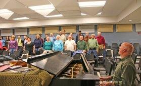 Naugatuck Community Choir Director Mark Silva, right, plays the piano as the choir warms up during rehearsal May 8 at Naugatuck High School. The choir will perform its spring concert at 7:30 p.m. May 19 at St. Francis Xavier Church in Waterbury and at 4 p.m. May 21 at St. Hedwig Church in Naugatuck. –LUKE MARSHALL