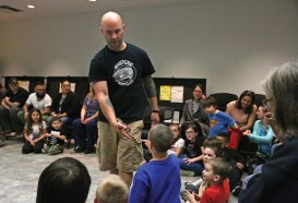 Brian Kleinman, owner of Riverside Reptiles, shows off a male tiger salamander May 2 at the Whittemore Library in Naugatuck during the Lizards at the Library program. Kleinman showed off amphibians and reptiles, such as the salamander and an African fat-tailed gecko, to a group of about 30 children and adults. –LUKE MARSHALL
