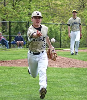 Woodland's Zack Bedryczuk flips the ball to first for an out May 10 against Naugatuck at Woodland Regional High School in Beacon Falls. –ELIO GUGLIOTTI