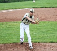 Woodland's Zack Graveline throws to first to try and pick off a base runner Tuesday versus Wolcott in the first round of the Class M tournament in Beacon Falls. Wolcott won the game, 13-6. –ELIO GUGLIOTTI