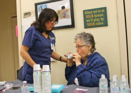 Marlene Scrivani, a respiratory therapist and asthma educator at the Northeast Medical Group, performs a breath test on Marie Tardy at the Naugatuck Senior Center on May 11 during the center's health and wellness clinic. The free clinic provided a variety of screenings and exams, including screenings for osteoporosis, blood pressure, and foot exams. Over 125 seniors took advantage of the clinic. –LUKE MARSHALL