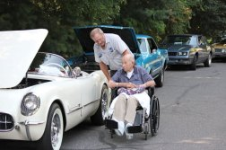 Jim Doback, standing, talks with his father, Charlie Doback Sr., 96, of Naugatuck, as they look over a 1954 Corvette July 20 during a car cruise at Beacon Brook Health Center in Naugatuck. Beacon Brook and the Oil Can Boys Car Club co-sponsored the cruise. The proceeds from the admission fee for cars were donated to Rose Hope Animal Refuge, a non-kill animal rescue nonprofit organization. Carvel on New Haven Road in Naugatuck donated 100 chocolate and vanilla Flying Saucer ice cream sandwiches for dessert. –ELIO GUGLIOTTI
