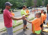 Kaylee Icokaitis, 8, of Beacon Falls, hands a lemonade to Beacon Falls public works employee Jeff Kean during the United Day School's annual lemonade stand Aug. 2 next to the firehouse on North Main Street. The school, which holds runs the stand every year, raised $450 during the sale. The money was donated to Beacon Falls police Officer Caroline O'Bar to help her fill backpacks with school supplies for children in need in the community. O'Bar buys backpacks and school supplies for local children who need them each year. –LUKE MARSHALL