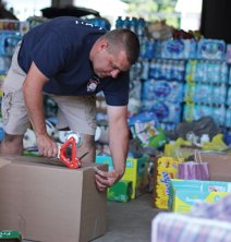 Former Beacon Hose Company No. 1 Chief James Trzaski tapes a box filled with donations closed at the firehouse in Beacon Falls on Aug. 30. Beacon Hose collected donations to aid Hurricane Harvey relief efforts and a group of firefighters volunteered to drive them to Texas. –ELIO GUGLIOTTI