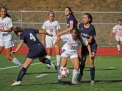 Naugatuck's Hailey Boulanger (11) weaves though Ansonia defenders Julia Catale (4) and Lizette Herrschaft Sept. 29 at Naugatuck High School. Naugatuck won the game, 7-1.