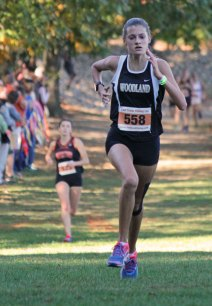 Woodland's Emma Slavin races to the finish line during the Naugatuck Valley League cross country championship meet Oct. 18 at Veterans Park in Watertown. Slavin finished seventh overall. The Woodland girls placed third. –ELIO GUGLIOTTI