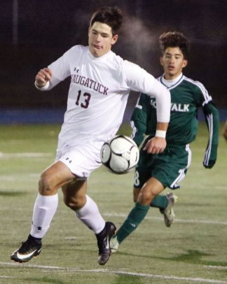 Naugatuck's Samuael Rego (13) controls the ball in front of Norwalk's Will Gaviria (28) during the Class LL semifinal Monday in Newtown. Naugatuck won the game, 1-0, in overtime. - STEVEN VALENTI/REPUBLICAN-AMERICAN
