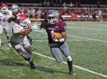 Naugatuck's Doreon Chapman (4) stiff arms Wolcott's Matthew Romeo (58) Nov. 3 at Naugatuck High School. Naugatuck won the game, 61-22. –ELIO GUGLIOTTI