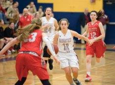 Naugatuck's Mia Rotatori (11) drives to the basket on Wolcott's Jenna Hoban (23) during a NVL semifinal game Monday at Kennedy High School in Waterbury. Naugatuck won, 45-36. -JIM SHANNON/REPUBLICAN-AMERICAN