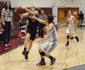 Woodland's Katie Sirowich (3) controls a pass in front of Naugatuck's Shannon Burns Tuesday at Naugatuck High School. Naugatuck won the game, 51-23. -JIM SHANNON/REPUBLICAN-AMERICAN