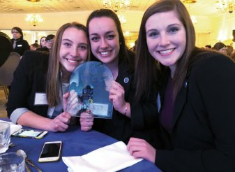 Woodland Regional High School DECA students, from left, Eliza Smith, Kristen Persico and Shannon Pruzinsky won first place for their community service project at the DECA Connecticut Career Development Conference March 6 at the Aqua Turf in Plantsville. -CONTRIBUTED