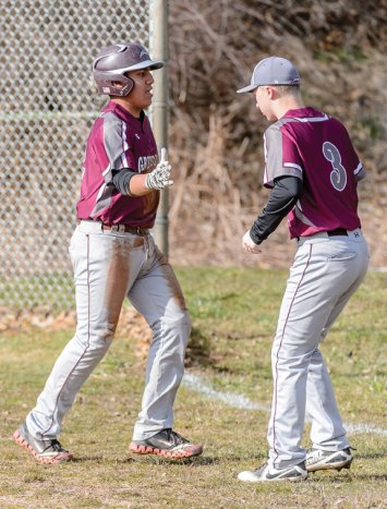Naugatuck's Tommy Ayash (12) celebrates with teammate Nick Bruno (3) after scoring a run against Sacred Heart at Fulton Park in Waterbury on Monday afternoon. Sacred Heart won the game, 6-2. -BILL SHETTLE/REPUBLICAN-AMERICAN