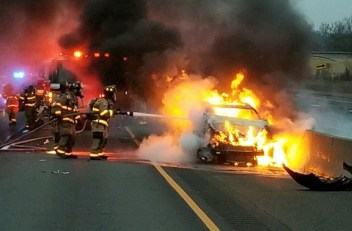 Firefighters battle a car fire on Route 8 north in Beacon Falls near the Seymour line Monday. –CONTRIBUTED