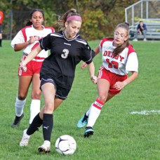 Woodland's Sara Alessio (3) pushes the ball toward the box as Derby's Dahiana Rodriguez-James (4) and Natalia Gruszkos (13) give chase during a game Oct. 19 at Woodland Regional High School in Beacon Falls. –ELIO GUGLIOTTI