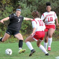 Woodland's Aries Bell (7) winds up to shoot in front of Derby's Jessica Gerkens (10) and Aaliyah Hiecks (18) during a game Oct. 19 at Woodland Regional High School in Beacon Falls. Bell earned All-State and All-Copper Division honors for the fall season. –ELIO GUGLIOTTI
