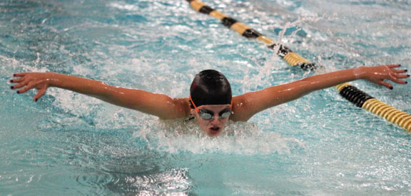 Woodland's Kyla Behrle competes in the 100 butterfly during a meet against Seymour Oct. 27 at Woodland Regional High School in Beacon Falls. –ELIO GUGLIOTTI