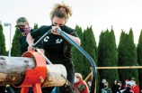 Marissa O'Rourke, one the senior captains of the Woodland timber team, competes in the cross cut competition during the inaugural Woodland Battle Royal on Nov. 20 at Woodland Regional High School in Beacon Falls. -JIM SHANNON/REPUBLICAN-AMERICAN