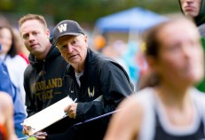 Woodland cross country coach Jeff Lownds watches as one of his runners makes her way to the finish line during the NVL cross country championships in 2018 at Veterans Memorial Park in Watertown. -REPUBLICAN-AMERICAN ARCHIVES