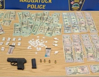 Naugatuck police say this crack cocaine, heroin, cash and a semi-automatic pistol were found Friday night after a pursuit of a car. –CONTRIBUTED