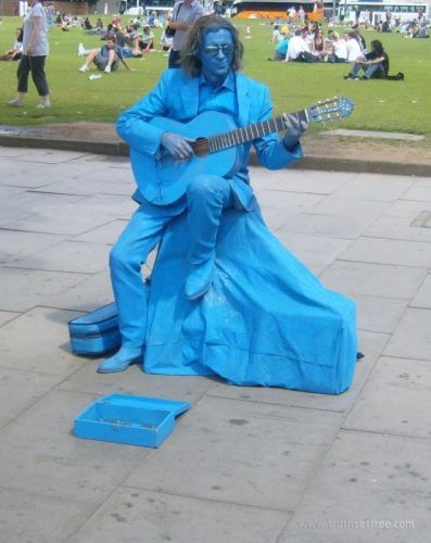 blue man plays the blues