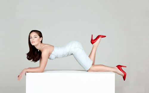 Kristin Kreuk on her knees with red shoes