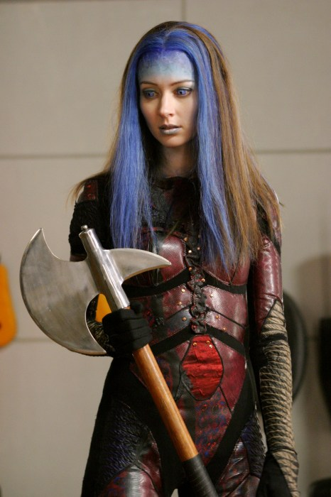 Fred with blue hair and an axe