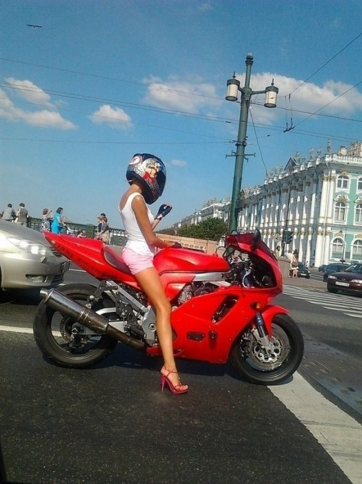 high heel motorcyclist