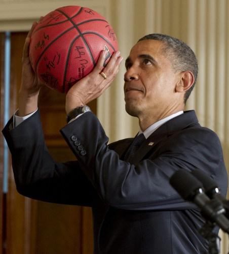 obama has a basketball