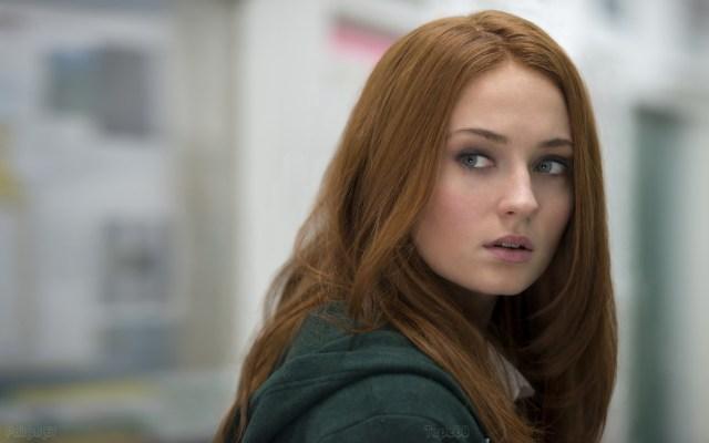 red head looking over her shoulder.jpg