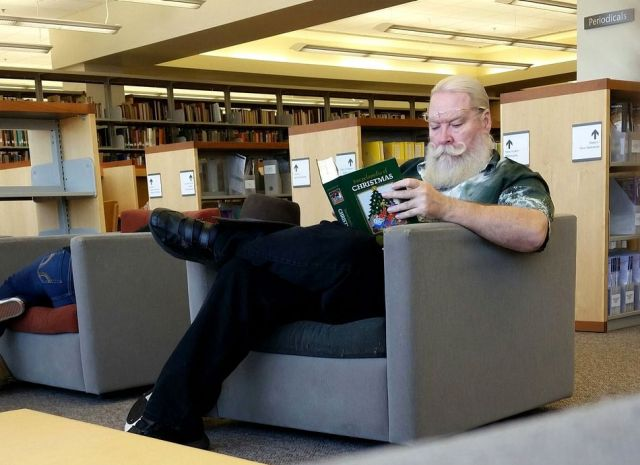santa brushing up at the library.jpg