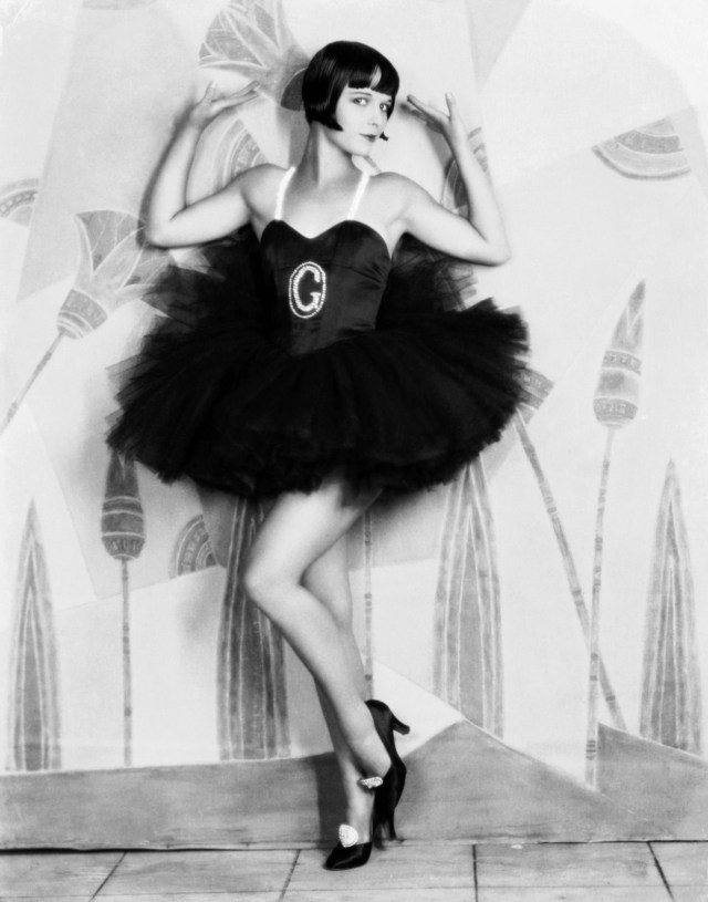 """1927: American actress Louise Brooks (1906 - 1985) wearing a frilly dress with a large G on the front for the film """"Now We're In The Air"""". (Photo by Eugene Robert Richee)"""