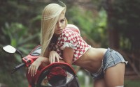 wind swept blonde leaning on a beautiful motorcycle.jpg