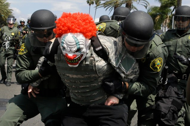 Orange County Sheriff's deputies take a protester into custody.jpg