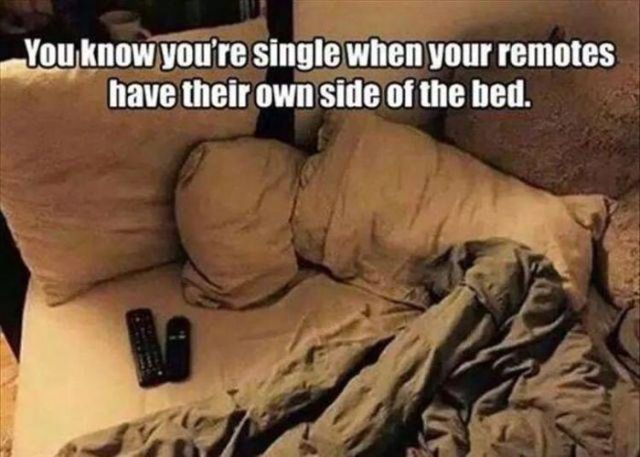 remotes in bed.jpg