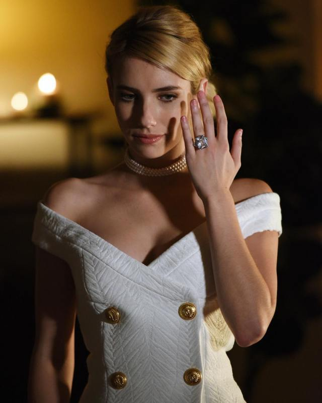 Emma Roberts with a large rock.jpg