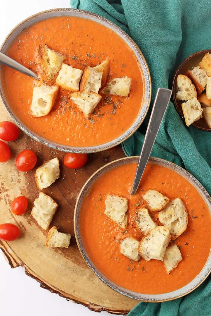 Two bowls of Vegan Tomato Soup with homemade croutons.