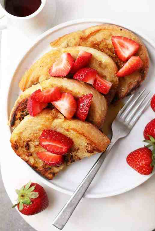 Classic vegan French Toast with strawberries and maple syrup.