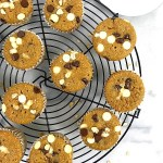 Top view of some oat muffins on a black cooling rack