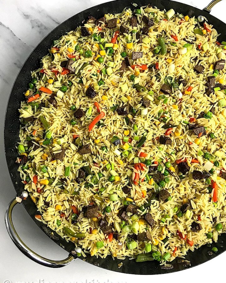 Top view of a paella pan with fried rice in it