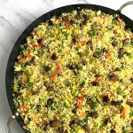 Top view of a Nigerian fried rice recipe dotted with chops of fried liver