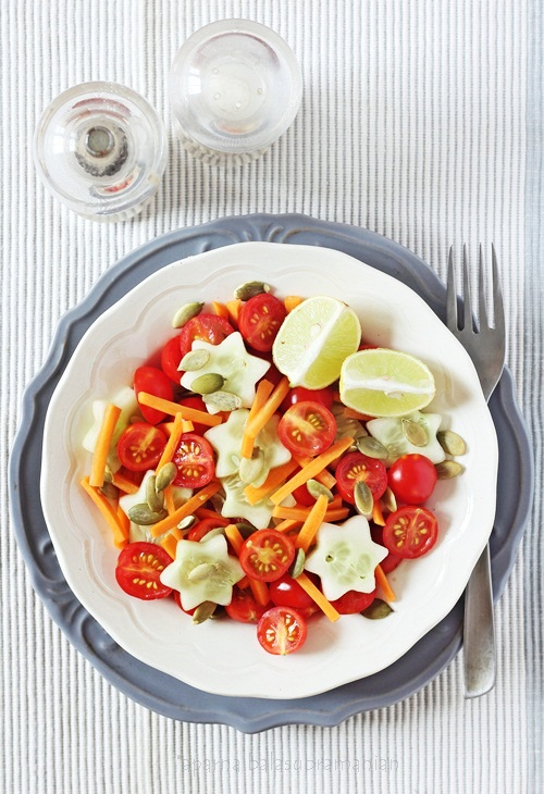 A Cherry Tomato, Cucumber & Carrot Salad With Pumpkin Seeds