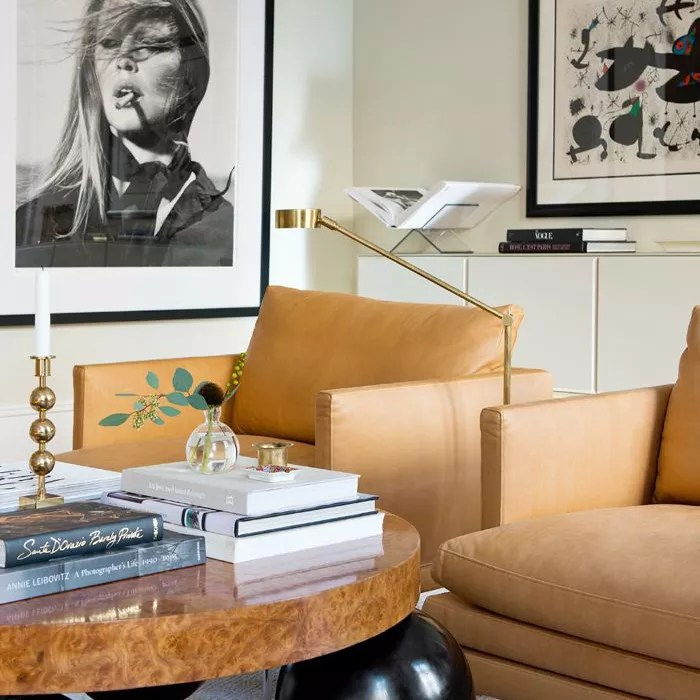 living room wall with large framed photographs on wall