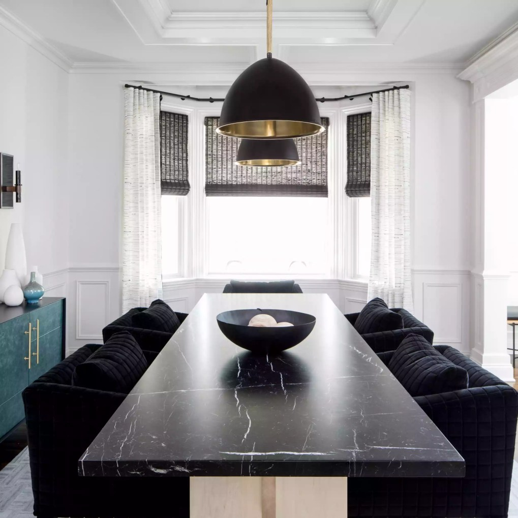Black dining room with oversized table