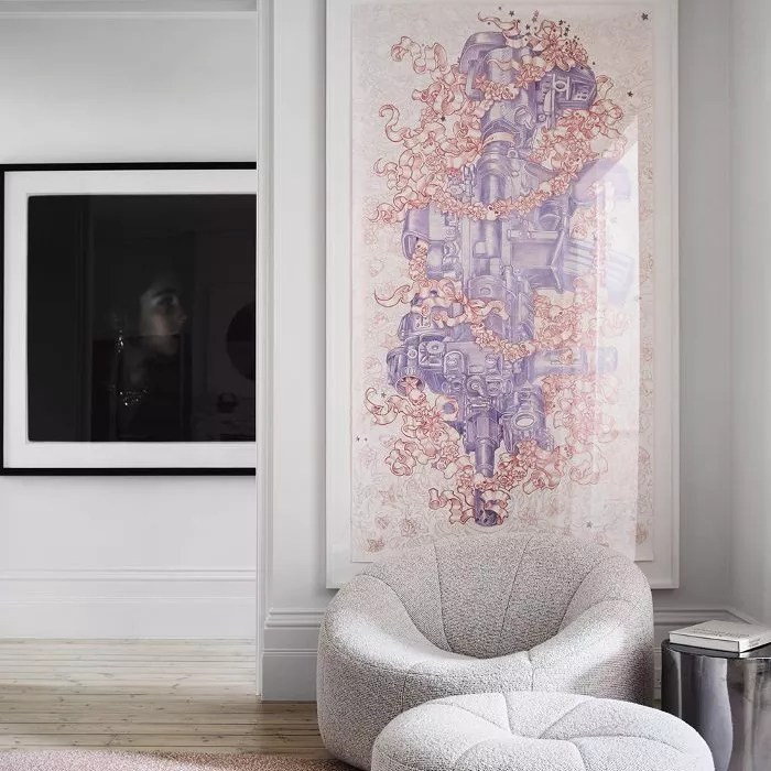 living room with large piece of hanging art