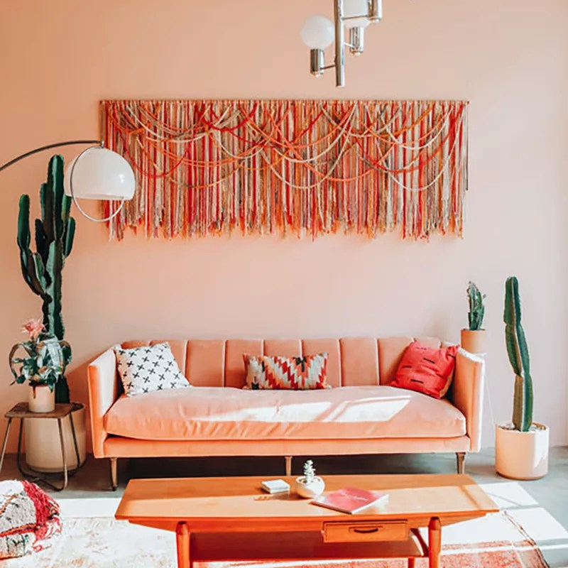 Bright living room with pinks and greens.