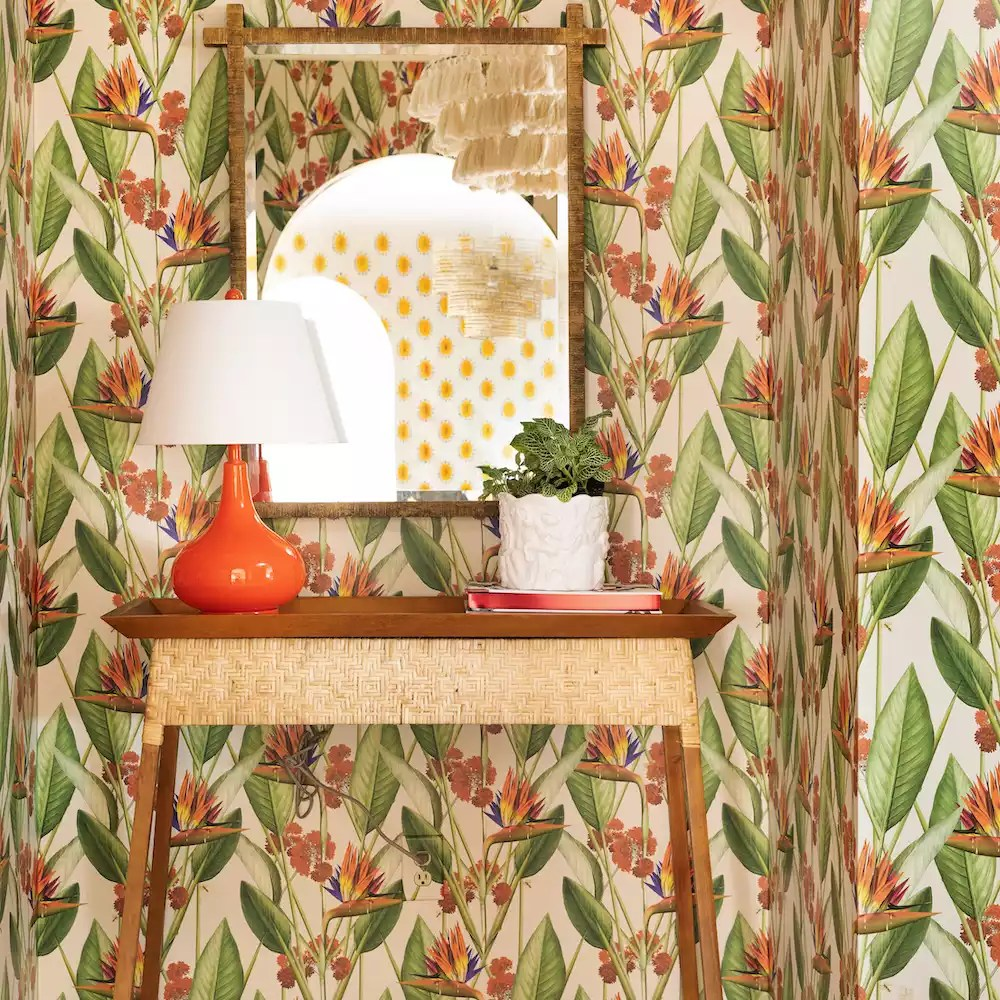 Vibrant entryway with tropical wallpaper.