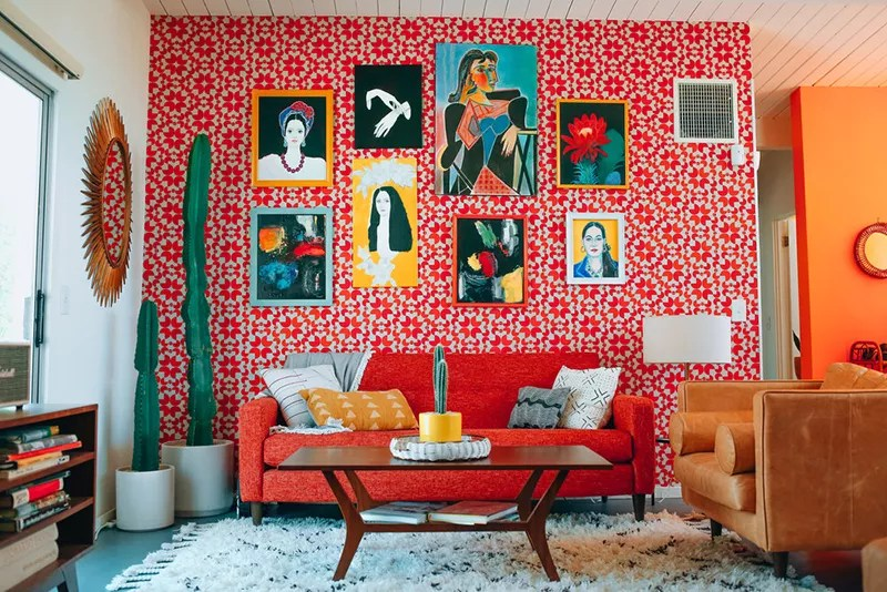 Bold living room with red pattern wallpaper.