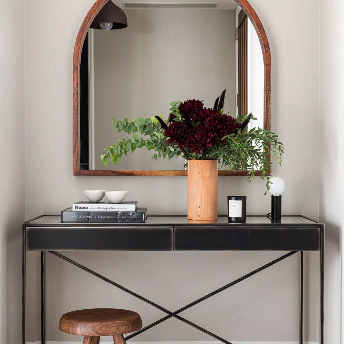 Neutral entryway with black table.