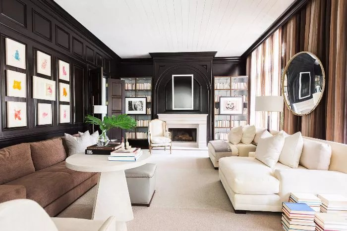 Living room features dark chocolate and caramel tones